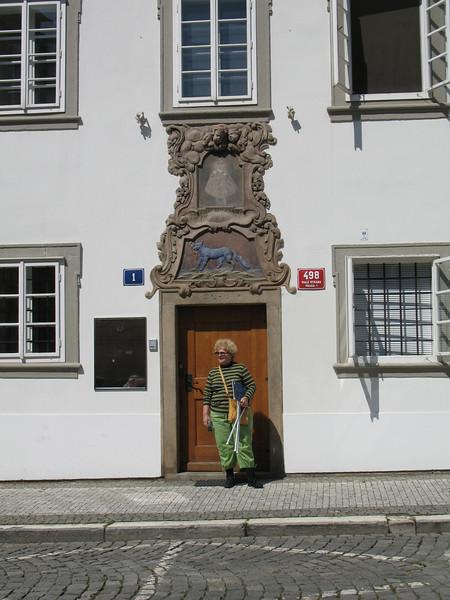 Judith in front of an ornate doorway