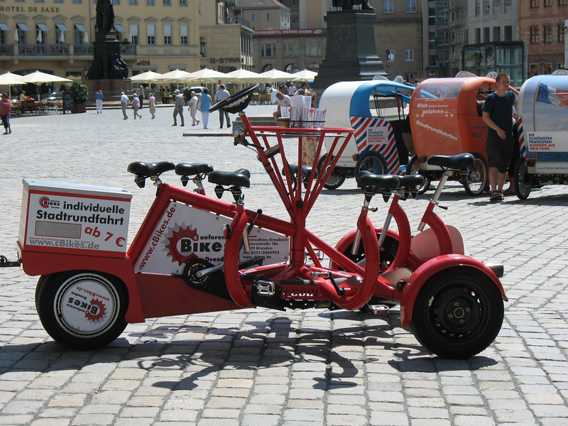 Five person tricycle - There are five seats and five sets of pedals