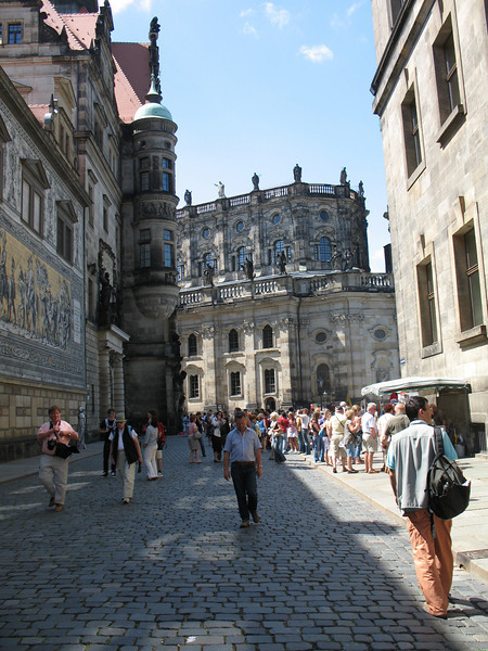 Tourists strolling past The Furstenzug - The Saxon Sovereigns (on the left)
