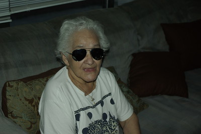This is Grandma saying good bye with my sunglasses on.  She is 81 years old.