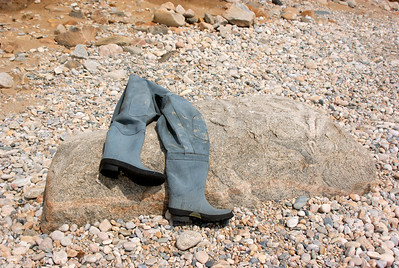 This photo of a fisherman's boots s/he was not so lucky to follow the signs.  This was basically a fisherman's rendition of the old witch seen on the popular movie the Wizard of OZ.  This rock was someones house.  They were tired of the fisherman telling them they lived under a rock.