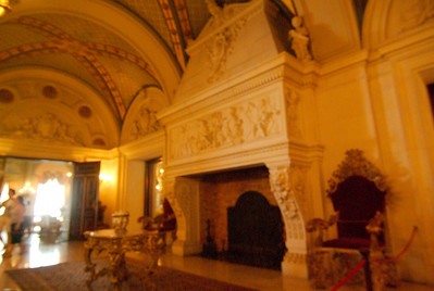 Out of focus shot of a fireplace inside adjacent to The Grand Hall.