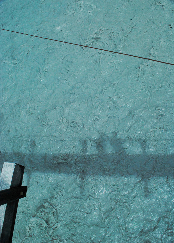 Our shadows on the glacial melt. Franz Josef.