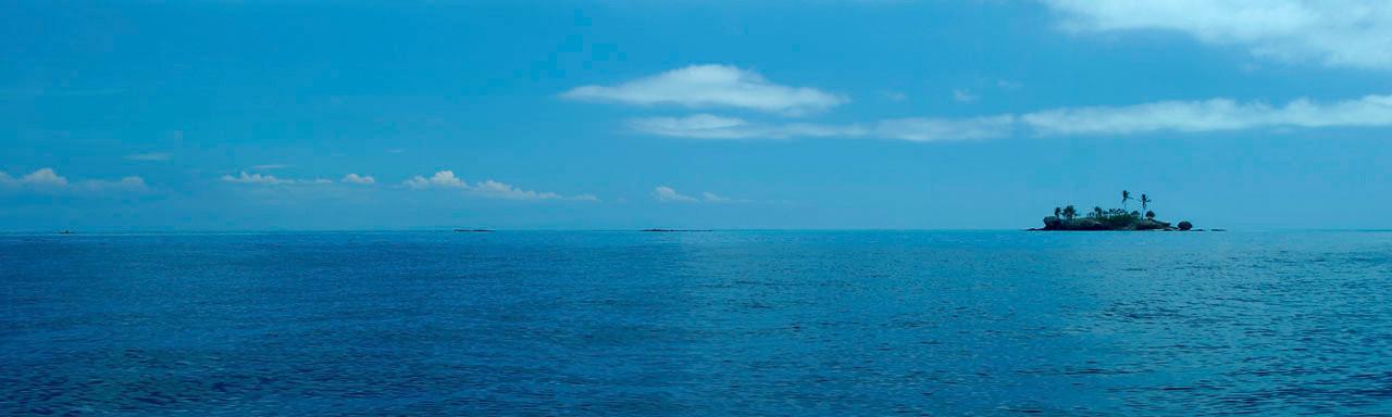 Tiny islet in Matayalevu Bay, Fiji.