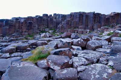 "Although the basaltic columns of the Giant's Causeway are impressive, they are not unique. Basalt columns are a common volcanic feature, and they occur on many scales (faster cooling produces smaller columns). Other notable sites include Fingal's Cave and the 'Kilt Rock' on Skye in Scotland, North of Hov on Suduroy in the Faroe Islands, Jusangjeolli on Jeju Island, South Korea, the Garni gorge in Armenia, the Cyclopean Isles near Sicily, Devils Postpile National Monument in California, The Cove Palisades State Park in eastern Oregon, Devils Tower National Monument in Wyoming, Santa Maria Regla Basalt Prisms in Hidalgo, Mexico, the ""Organ Pipes"" formation on Mount Cargill in New Zealand, Chongsokjong in North Korea, the giant ""Rocha dos Bordões"" (""Rod Rock"") formation in Flores (Azores), at Gành Đá Đĩa in the Phú Yên province of Vietnam.and the ""Columnar Cape"" (Russian: Mis Stolbchaty) on Kunashir, the southernmost of the Kurile Islands in Russia."