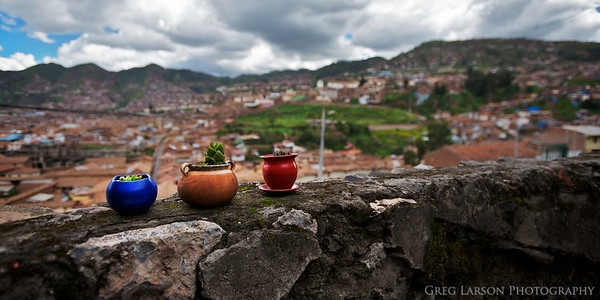 Pots on a wall overlooking Cusco.
