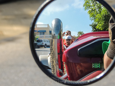 My mom's picture in their rear view mirror