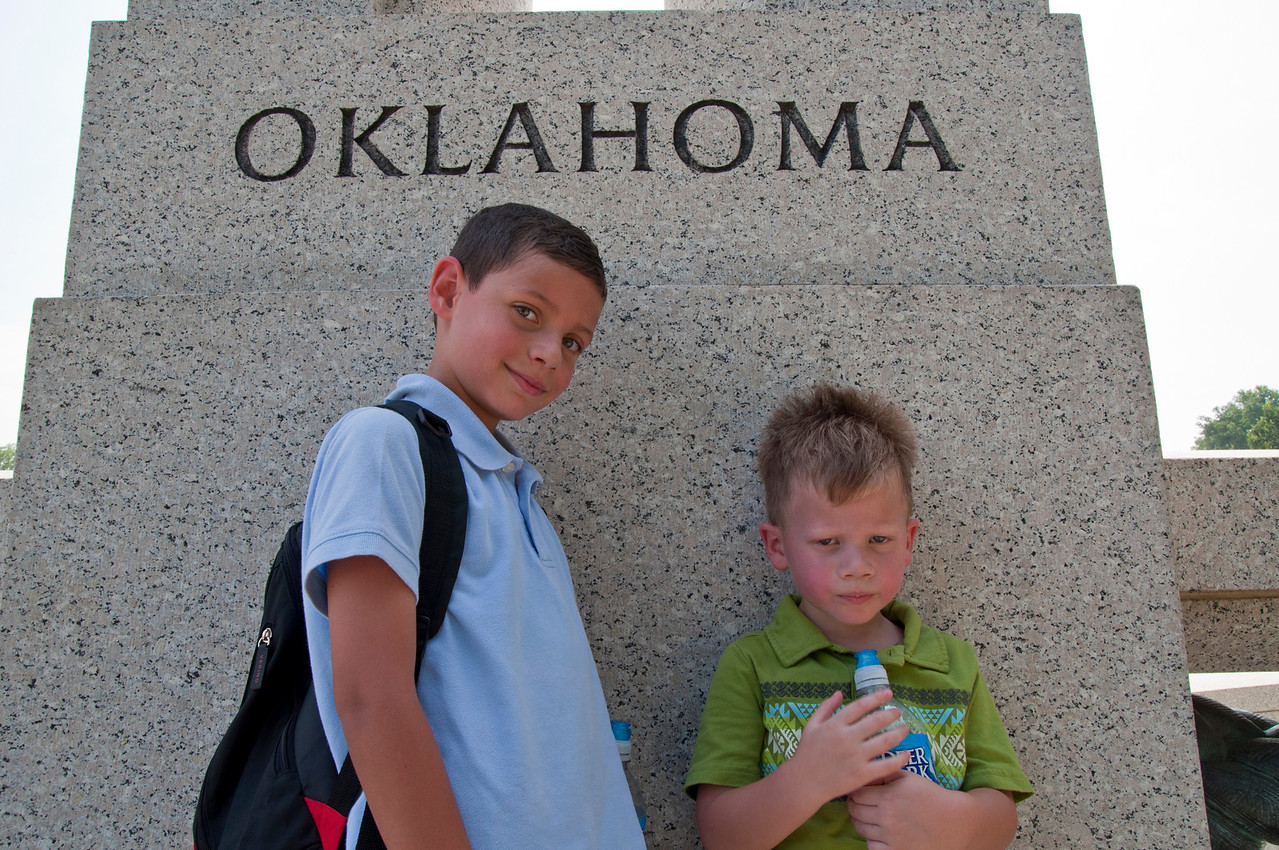 Boys taking refuge in the shade of the Oklahoma post at the WWII memorial.
