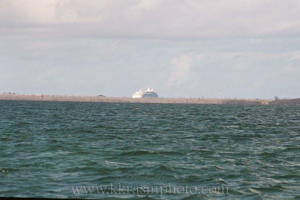 This is on our way out to Stingray City, looking back at the ship & island.
