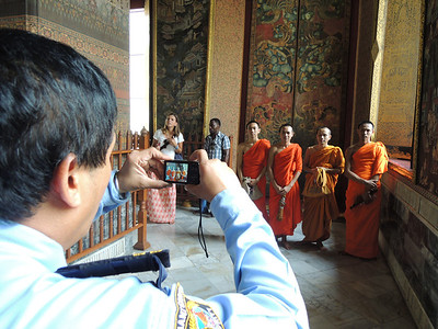 Once I took my photo, everyone wanted a photo of the young monks. There was some confusion about whether I wanted a photo of myself with their camera which somehow turned into a security guard using one of the monk's cameras to take a photo of them.