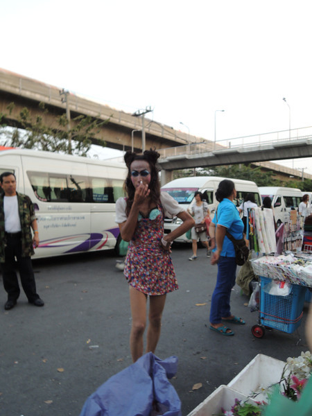 "Outside the market, on the way back to the sky train, we spot our first ""lady boy"". She's coating her nostrils with a eucalyptus stick to numb herself to the humid putridity that lingers in Bangkok. The offensive odors are impossible to get used to, and in a way, add to Bangkok's charm."