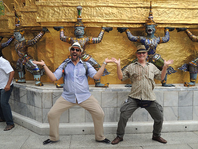 We hear American speakers, turn around and these guys are hamming it up with some warriors at the Grand Palace. They're from California, and are also dripping with sweat.
