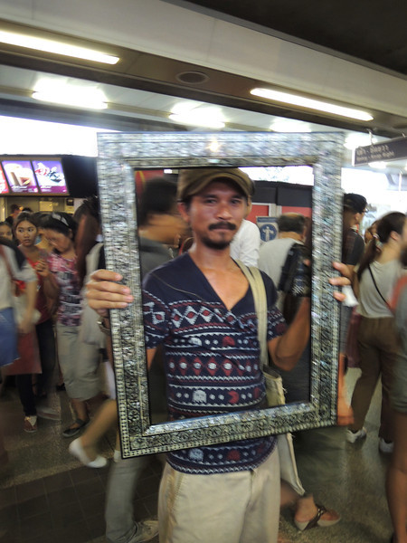 "Within seconds of rushing to the train, I manage to communicate ""I like your frame! Can you lift it up so I can take a picture of you in it?"" before I get whisked away by the crowd. There's a glint of a smile under that mustache. You can see it, right?"