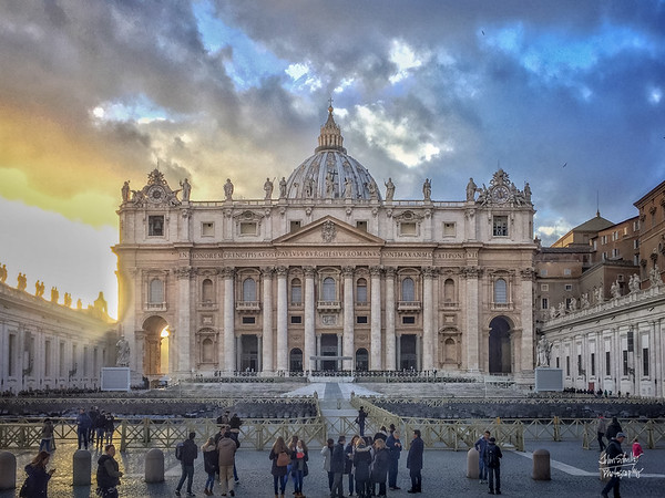 Glowing sun set's behind St. Peter's Basilica