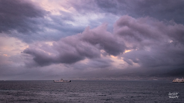 Sunset approaches as the clouds gather in the strait between Villa san Gionvanni and Messina.