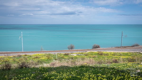 """The railroad runs peacefully along the Ionian Sea in the the """"arch"""" of the Italian boot. The area is called Roseto Capo Speluco - in Calabria."""