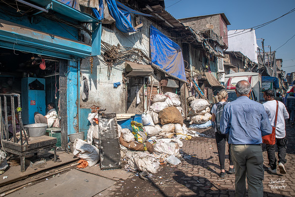 "As we walked deeper into the slums, we saw the beginnings of the recycling and other ""industries"" that drive the income of the residents."