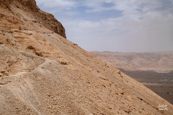 Steps and paths zig zag up Masada