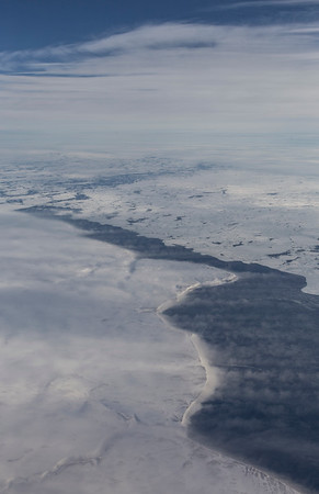 Rows of snow blowing off the eastern coast of Baffin Island