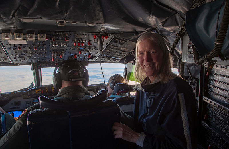 Claire in the P-3 cockpit with first views of sea ice on IceBridge