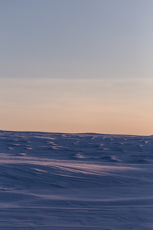 sunset across the drifted snow
