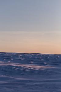 sunset across the drifted snow
