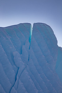 A close-up view of a crack in the blue ice