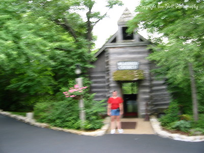 05/31/03  Heather standing in front of the Wilderness Church at Silver Dollar City.