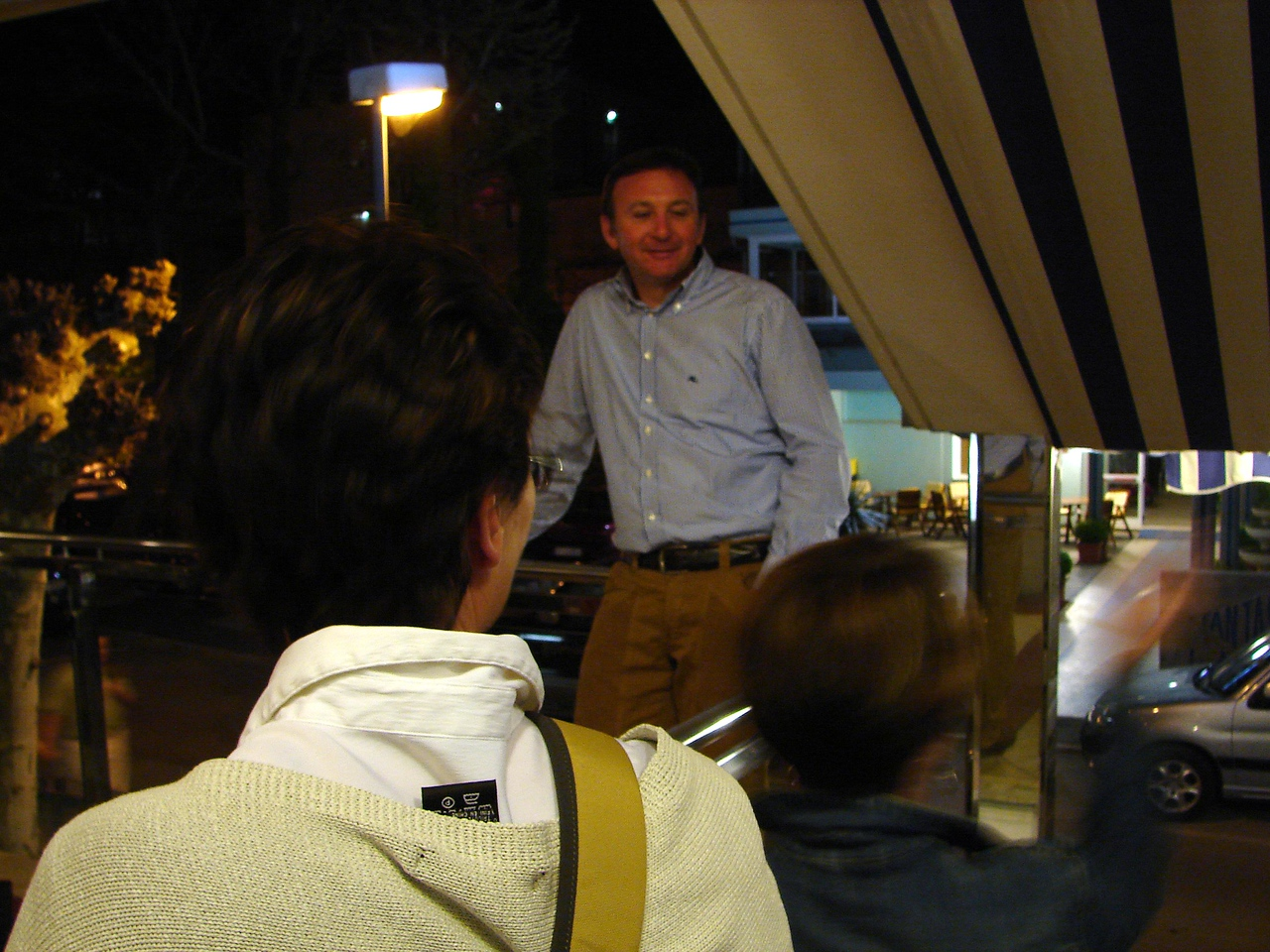 The owner of the hotel chatting up the girls.