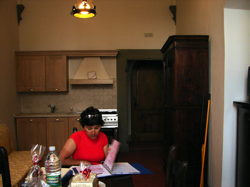 """Our apartment at Castello Vichimaggio in Greve. Reading the """"rules book"""""""
