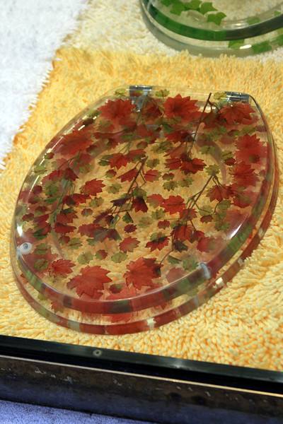 maple leaf toilet seat out of glass.