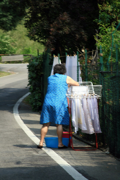 this woman was hanging her clothing on the fence beside her home...and literally on the road.