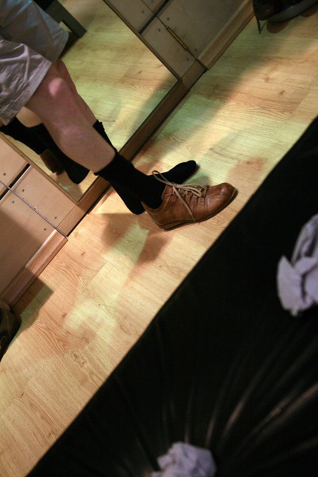 Archie buys shoes. shorts/black socks/brown shoes...nice jeff..nice!