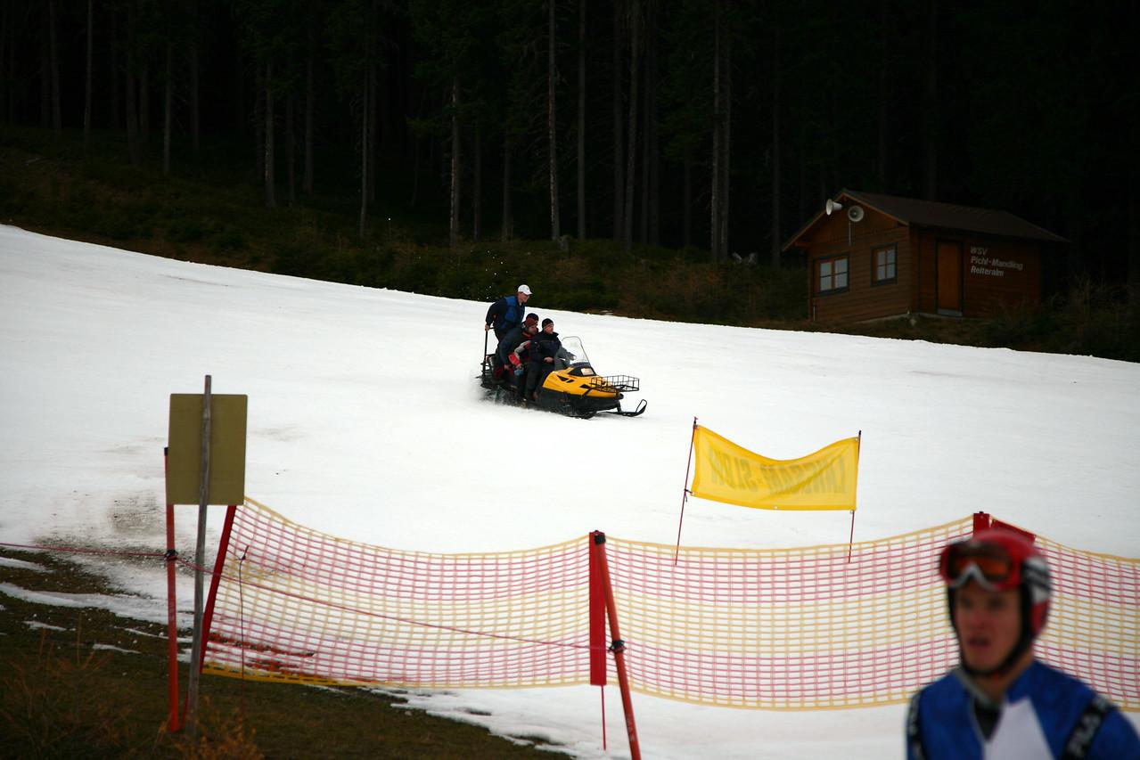 Four Austrians, one snowmobile.