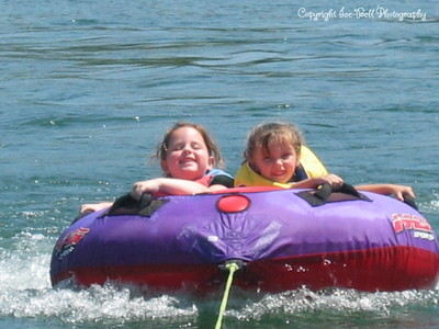 07/21/03  Ashlynn and Baylee out on the tube.  Look at those smiles!