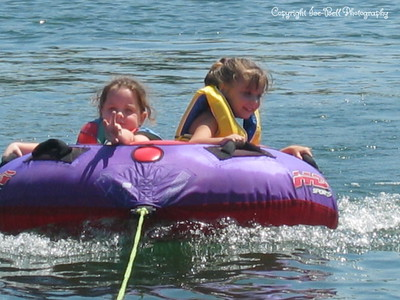 07/21/03  Ashlynn and Baylee out on the tube.  Ashlynn is wanting to go 2 faster.