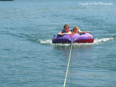 07/21/03  Ashlynn and Baylee out on the tube.