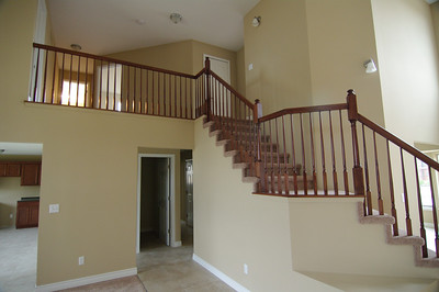 View of stairs and in that small door is a .5 bathroom.  Othe door is for the garage.