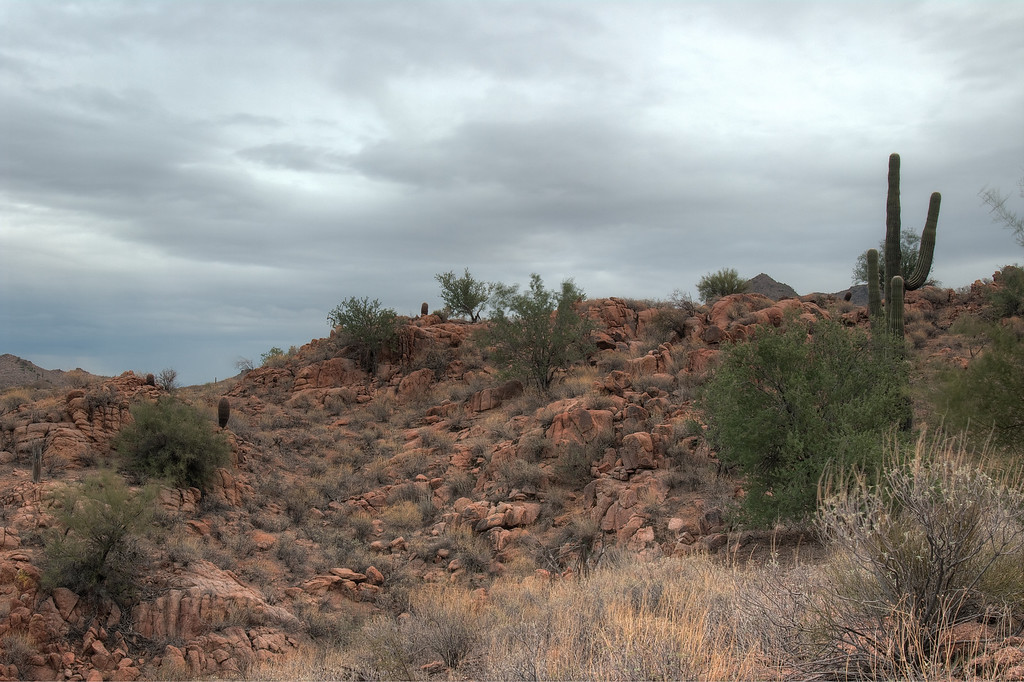 As I hiked to get a closer shot of a mountain I had to get around these hills.  Totally red and still relatively dry.