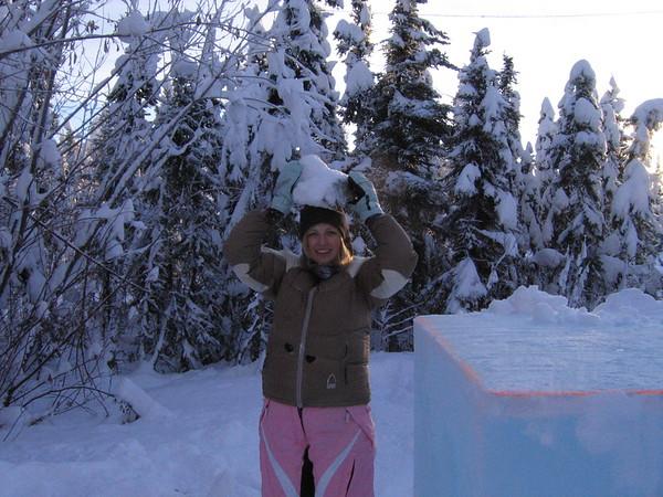 Jena, helping prepare the ice... nice hat.