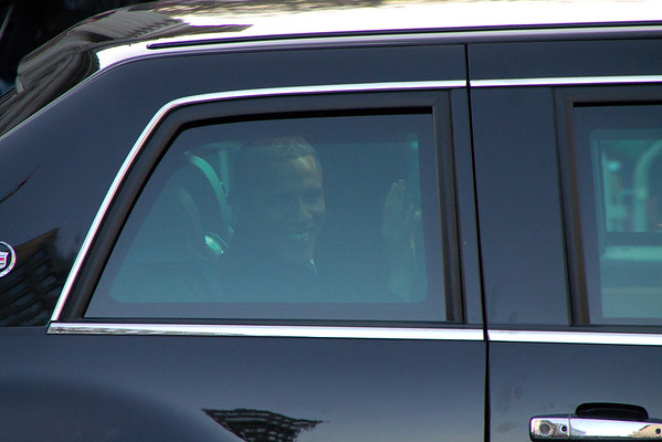 Obama driving by in his car