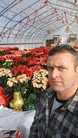 That's a lot of poinsettias... thinking of you mom!