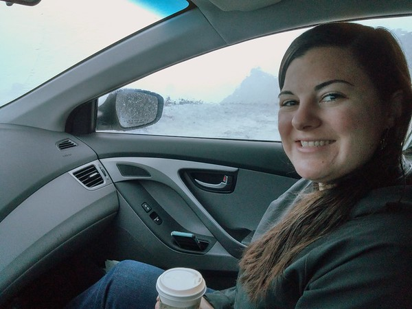 Kaitlin, being smart, and keeping out of the weather in the car