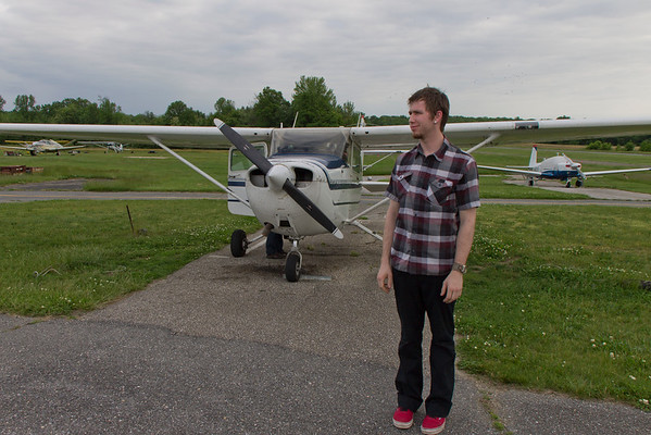 Cappy, all done with his a) first time in a small plane and b) first time flying a small plane. He's a bit queasy. =)