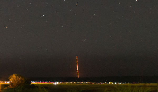 LADEE headed into the distance with a crowd of onlookers in the foreground