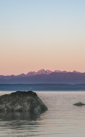 Sunrise on the Olympics from southern Whidbey Island.