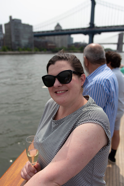 Kaitlin, enjoying some bubbly on the East River