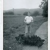 1952 August Bob feeding chickens