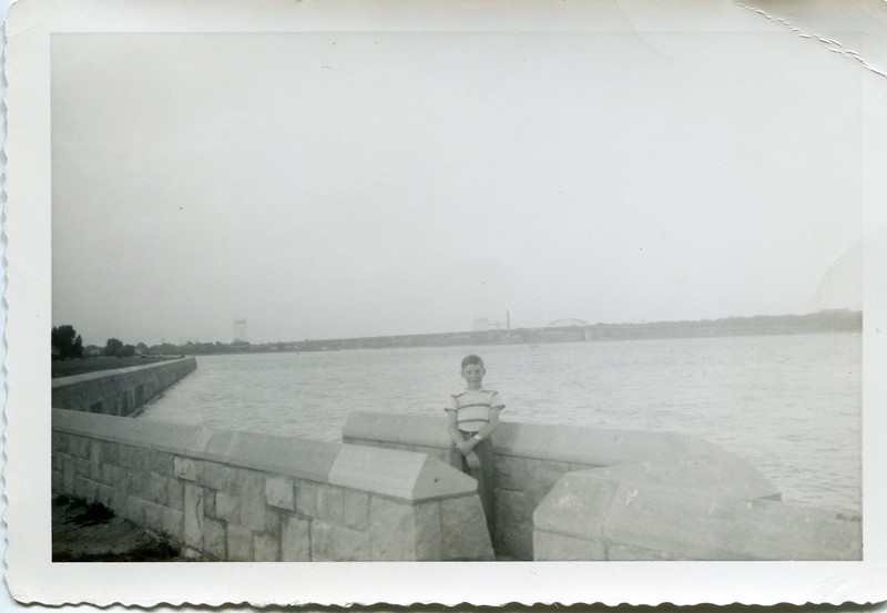 1951 Robert VanDeventer in Canada with Buffalo NY behind him