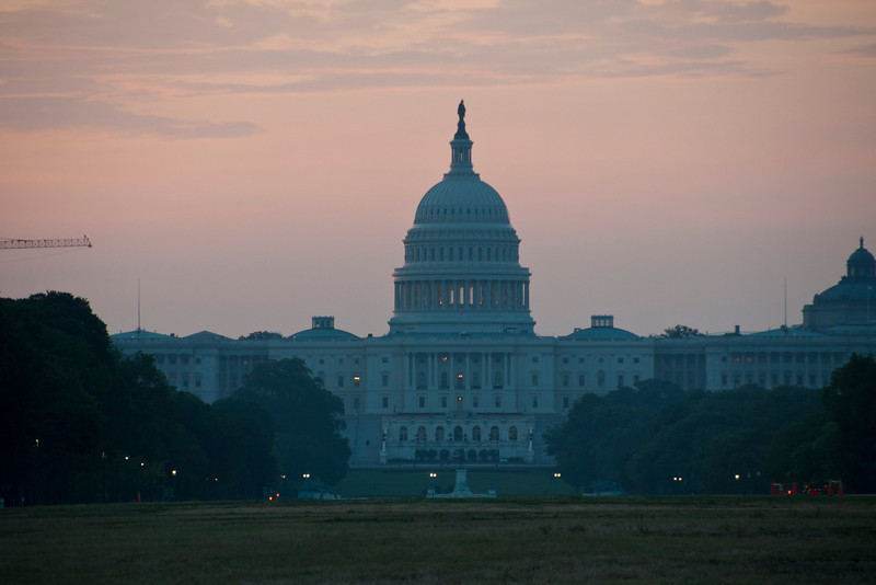 morning glow behind the US Capitol.